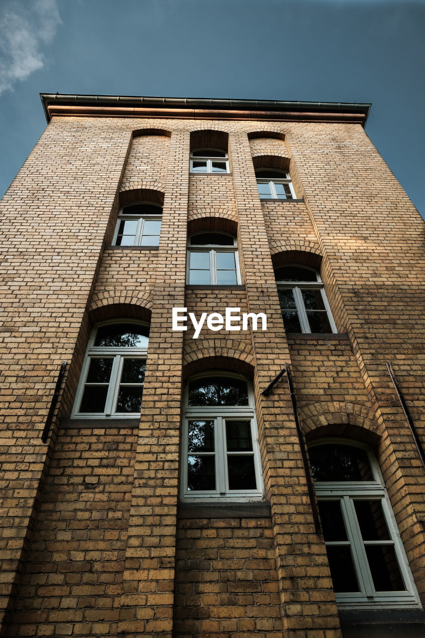 window, built structure, architecture, building exterior, low angle view, building, sky, no people, day, brick wall, wall, outdoors, brick, nature, residential district, old, city, glass - material, safety, history