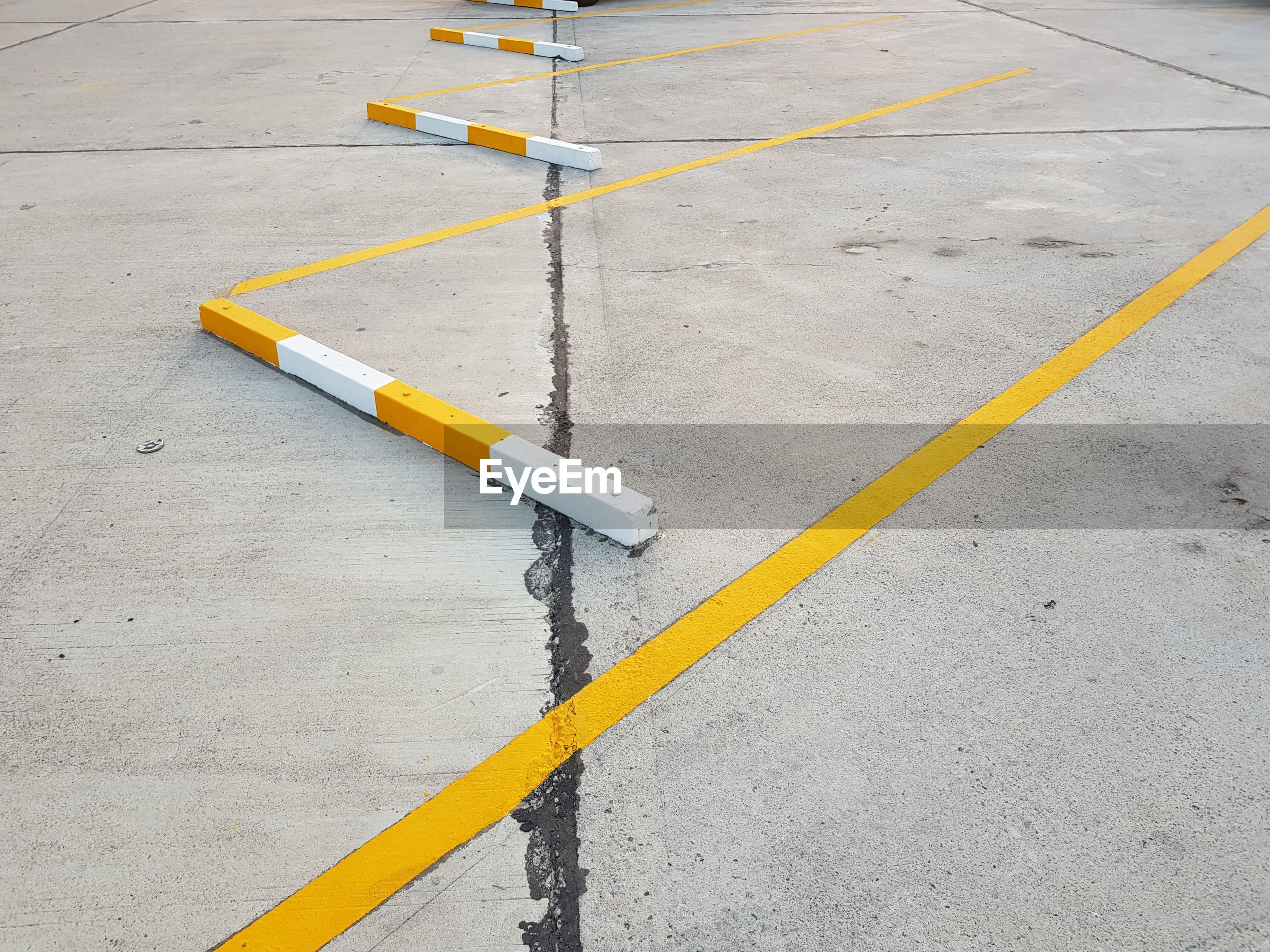 High angle view of yellow marking on road