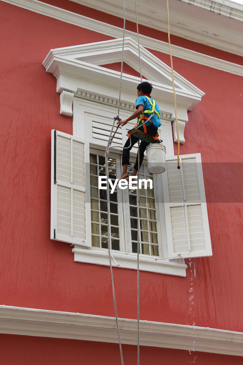 Architecture Building Exterior Danger Day Full Length Hanging Low Angle View Manual Worker Men Occupation Occupational Safety And Health One Man Only One Person Outdoors Protective Workwear Real People RISK Rope Safety Skill  The Photojournalist - 2017 EyeEm Awards Window Washer Working