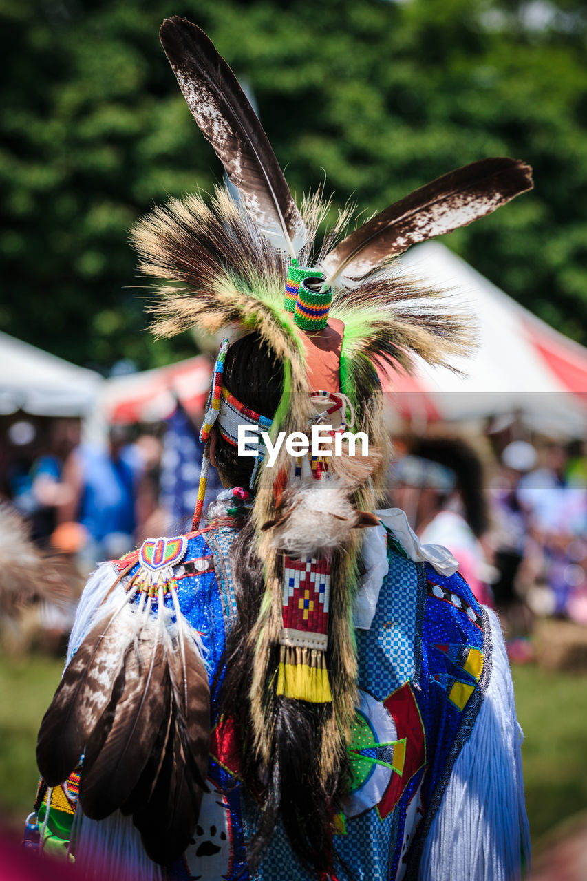 Rear View Of Man Wearing Headdress At Event