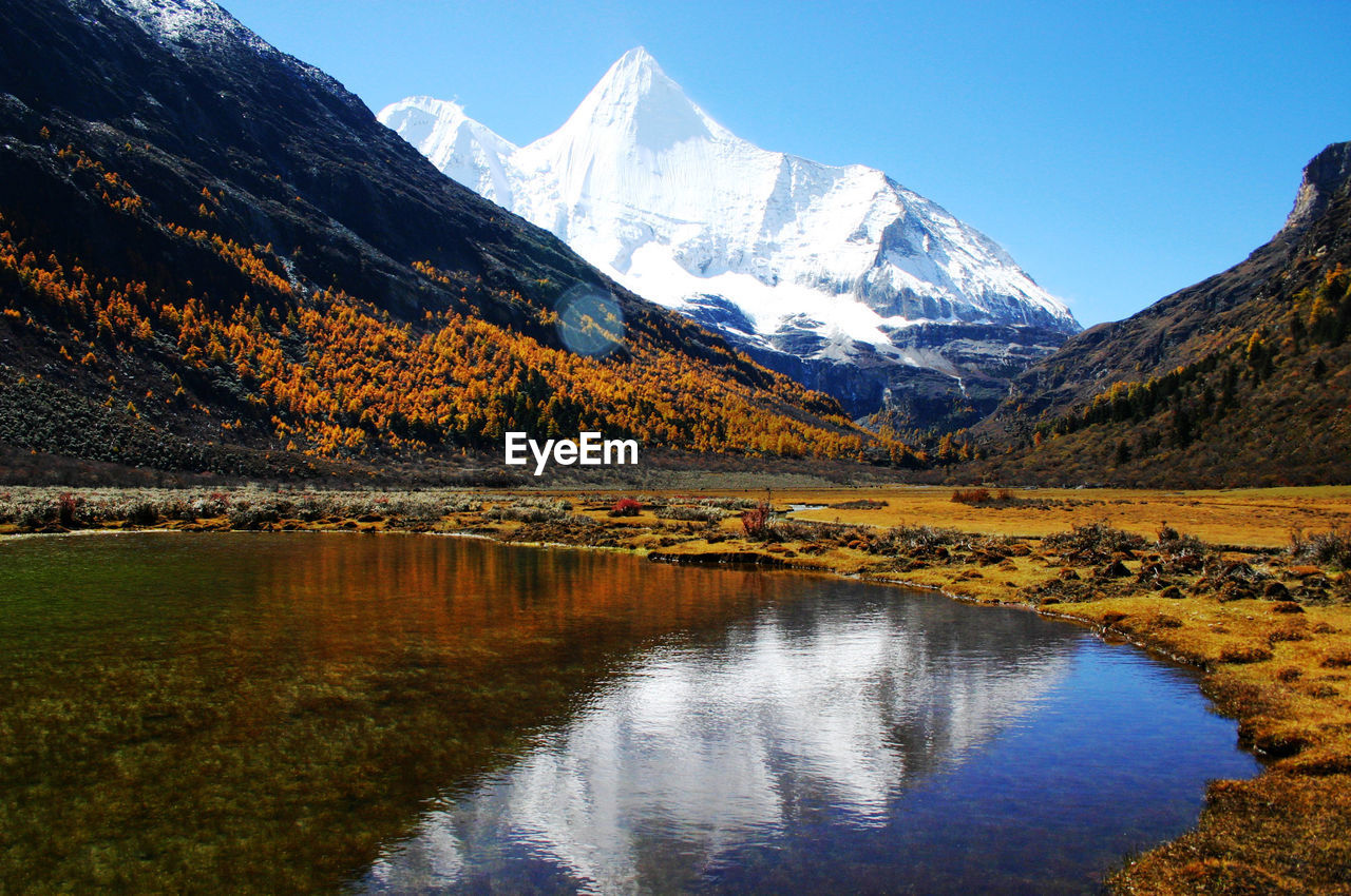 mountain, water, beauty in nature, scenics - nature, tranquil scene, tranquility, reflection, mountain range, sky, lake, environment, landscape, nature, waterfront, idyllic, no people, cold temperature, snow, winter, snowcapped mountain, mountain peak