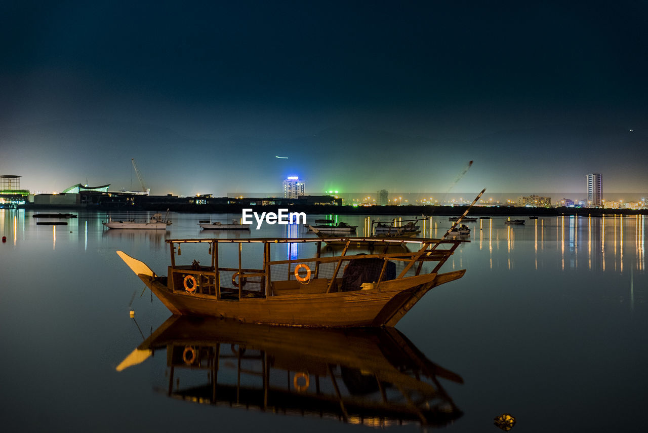 water, nautical vessel, sky, transportation, reflection, mode of transportation, waterfront, illuminated, no people, nature, night, moored, sea, scenics - nature, beauty in nature, outdoors, tranquility, architecture, fishing boat