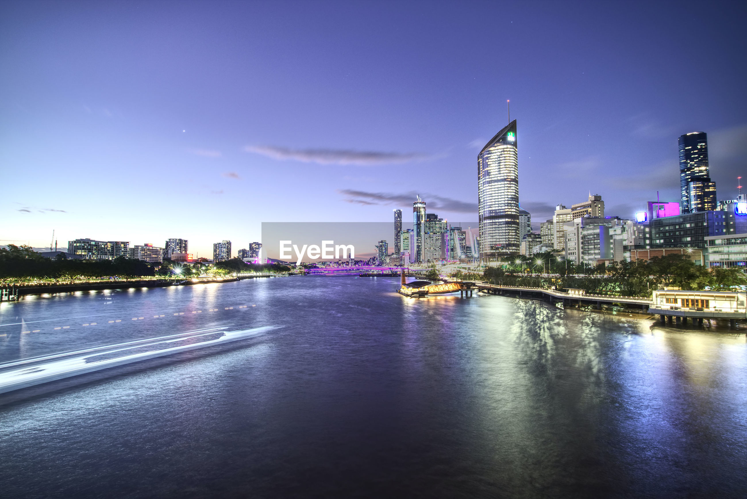 RIVER AND ILLUMINATED BUILDINGS AGAINST SKY
