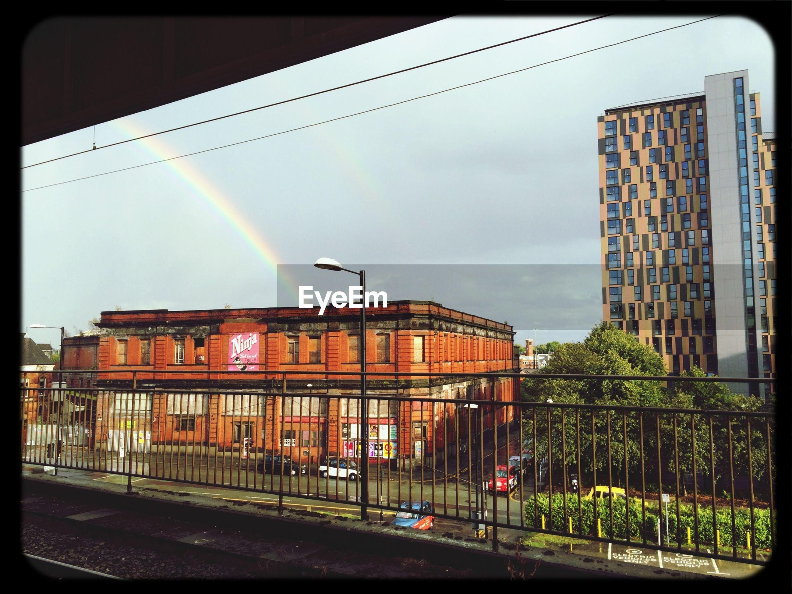 Rainbow over city buildings