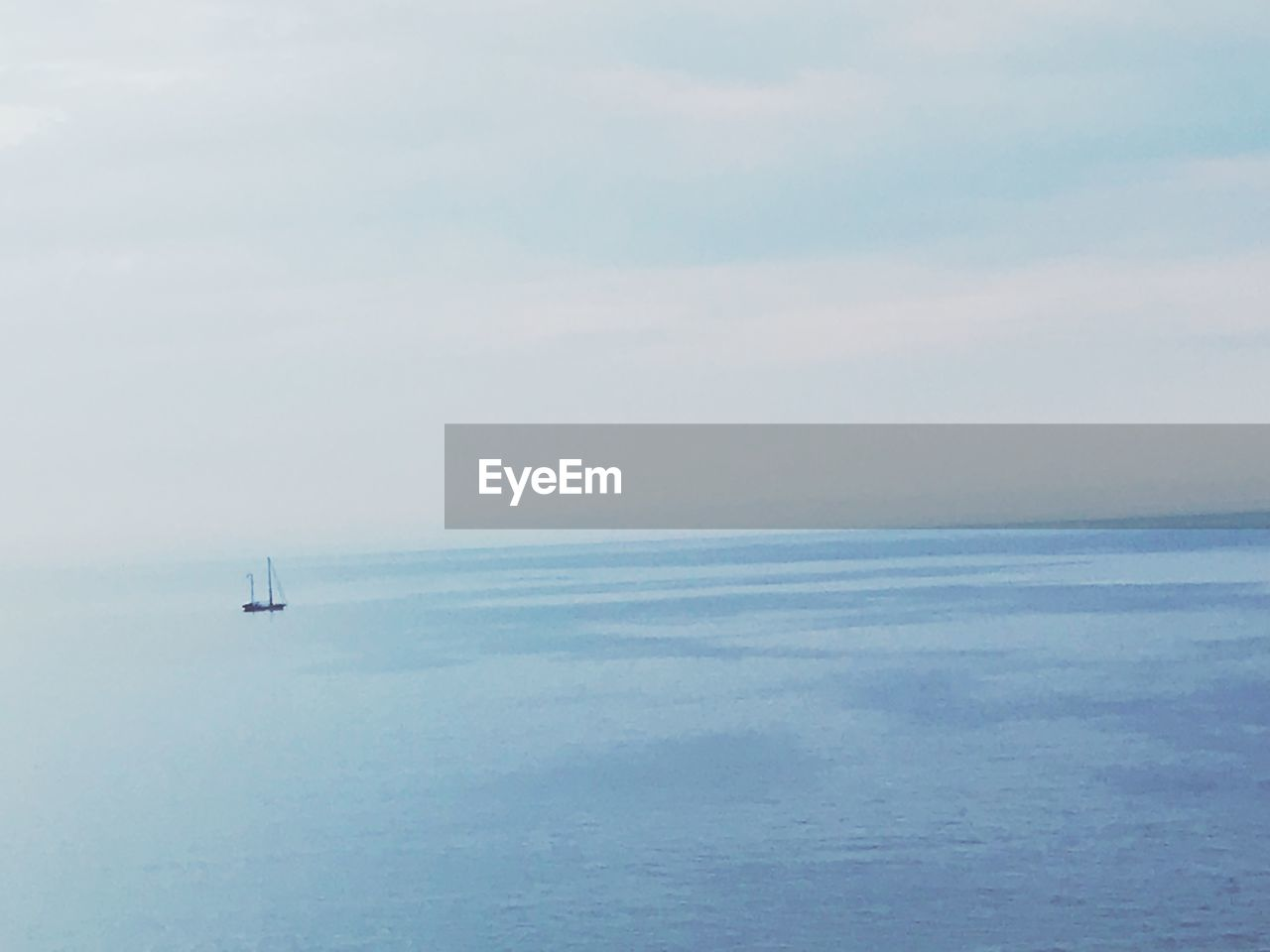 sea, water, horizon over water, scenics - nature, horizon, sky, beauty in nature, nautical vessel, transportation, mode of transportation, tranquil scene, tranquility, nature, day, no people, sailing, waterfront, cloud - sky, travel, outdoors, sailboat, anchored