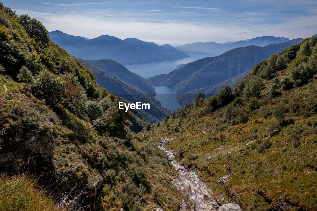 High Angle View Of Valley And Mountains Against Sky