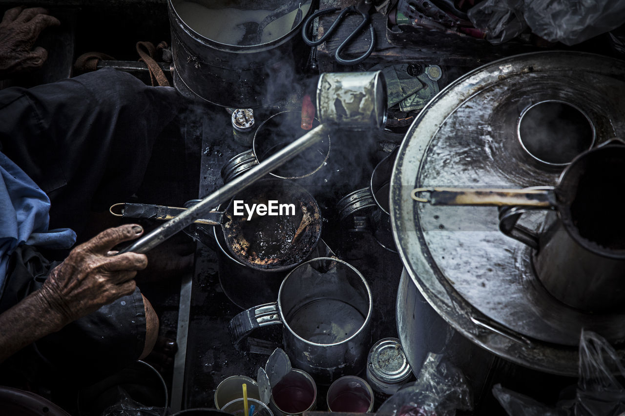 High angle view of person making hot drink
