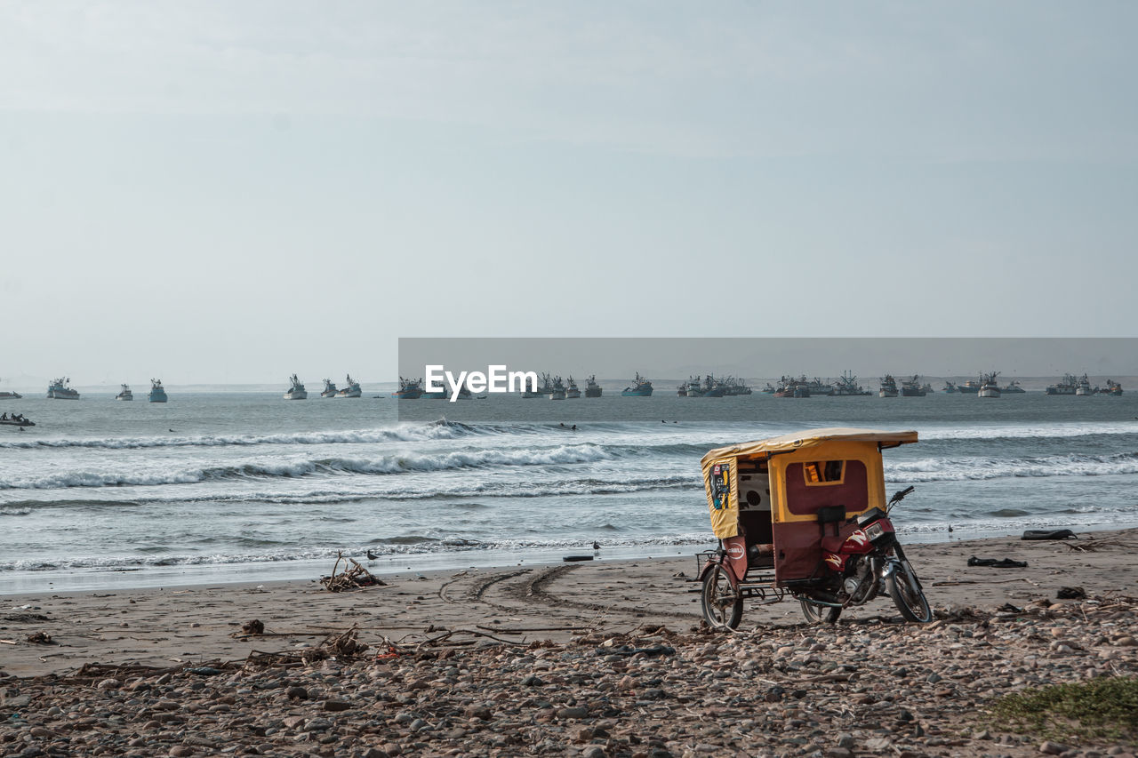 sea, water, sky, beach, land, transportation, mode of transportation, nature, scenics - nature, day, sand, horizon over water, horizon, land vehicle, beauty in nature, outdoors, motion, no people, nautical vessel