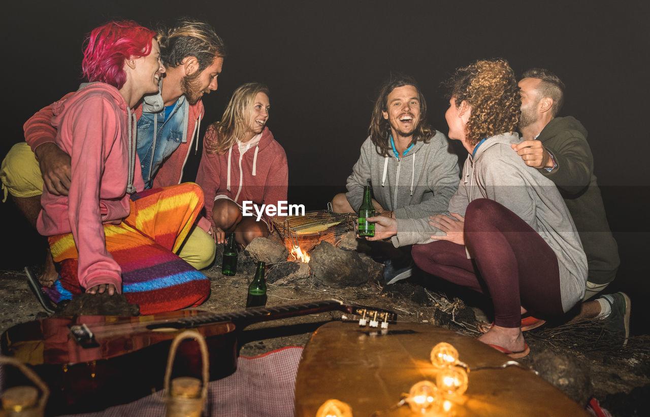 Friends camping at night