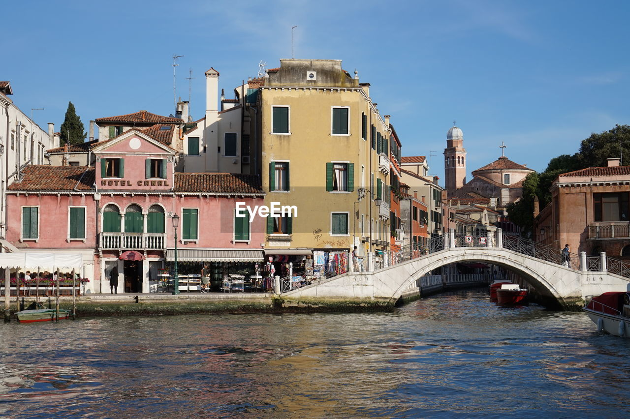 Arch Bridge Over Grand Canal In City Against Sky