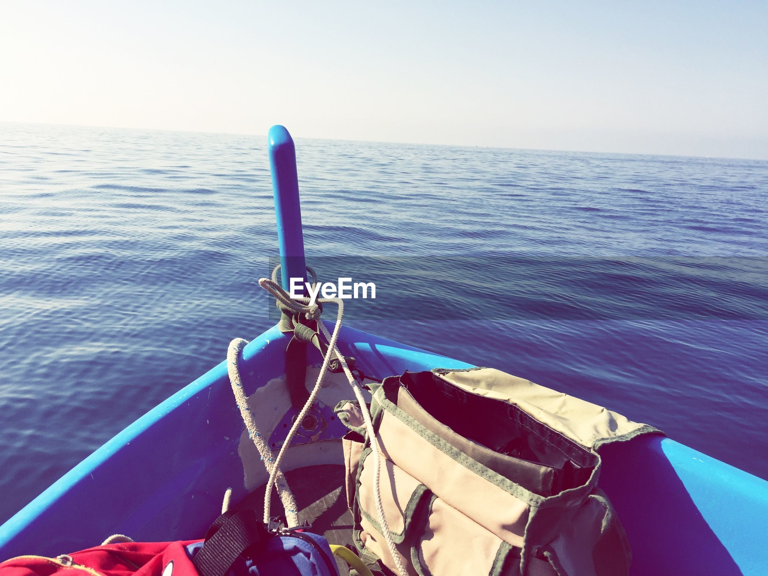 water, sea, nautical vessel, boat, horizon over water, transportation, mode of transport, tranquility, blue, moored, clear sky, tranquil scene, scenics, nature, beauty in nature, sky, rope, day, outdoors, travel