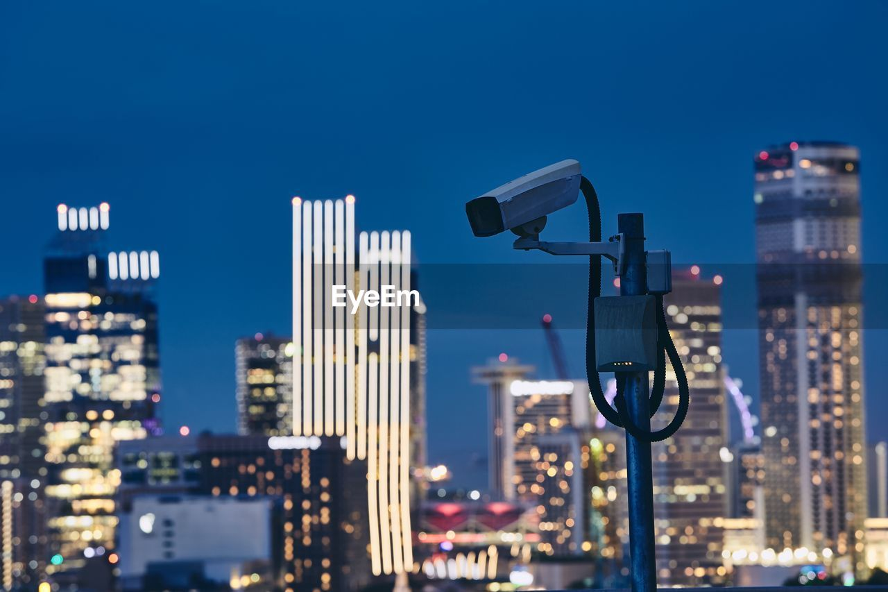 Security Camera Against Buildings In City