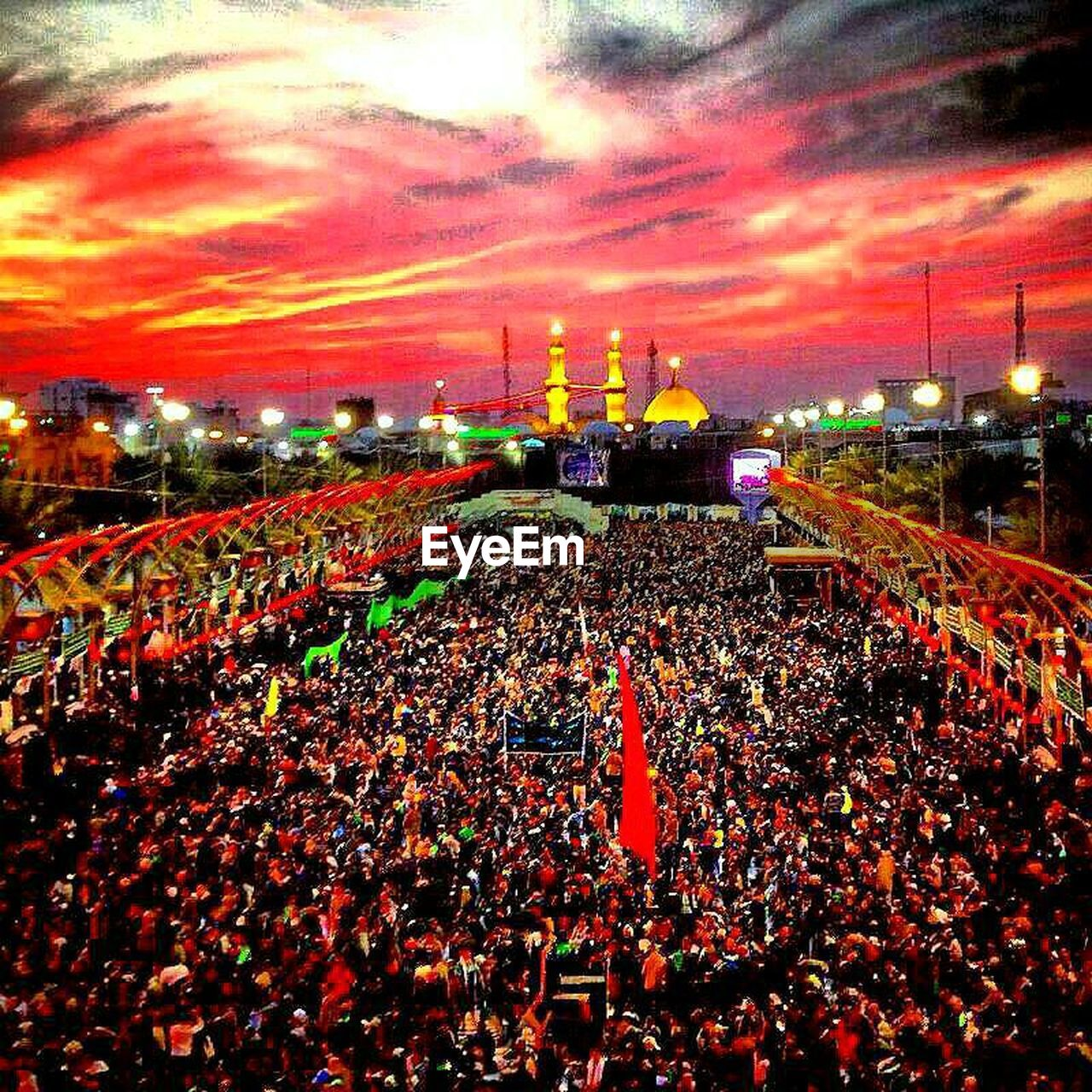 illuminated, large group of people, crowd, night, sky, cloud - sky, outdoors, building exterior, red, architecture, togetherness, city, people