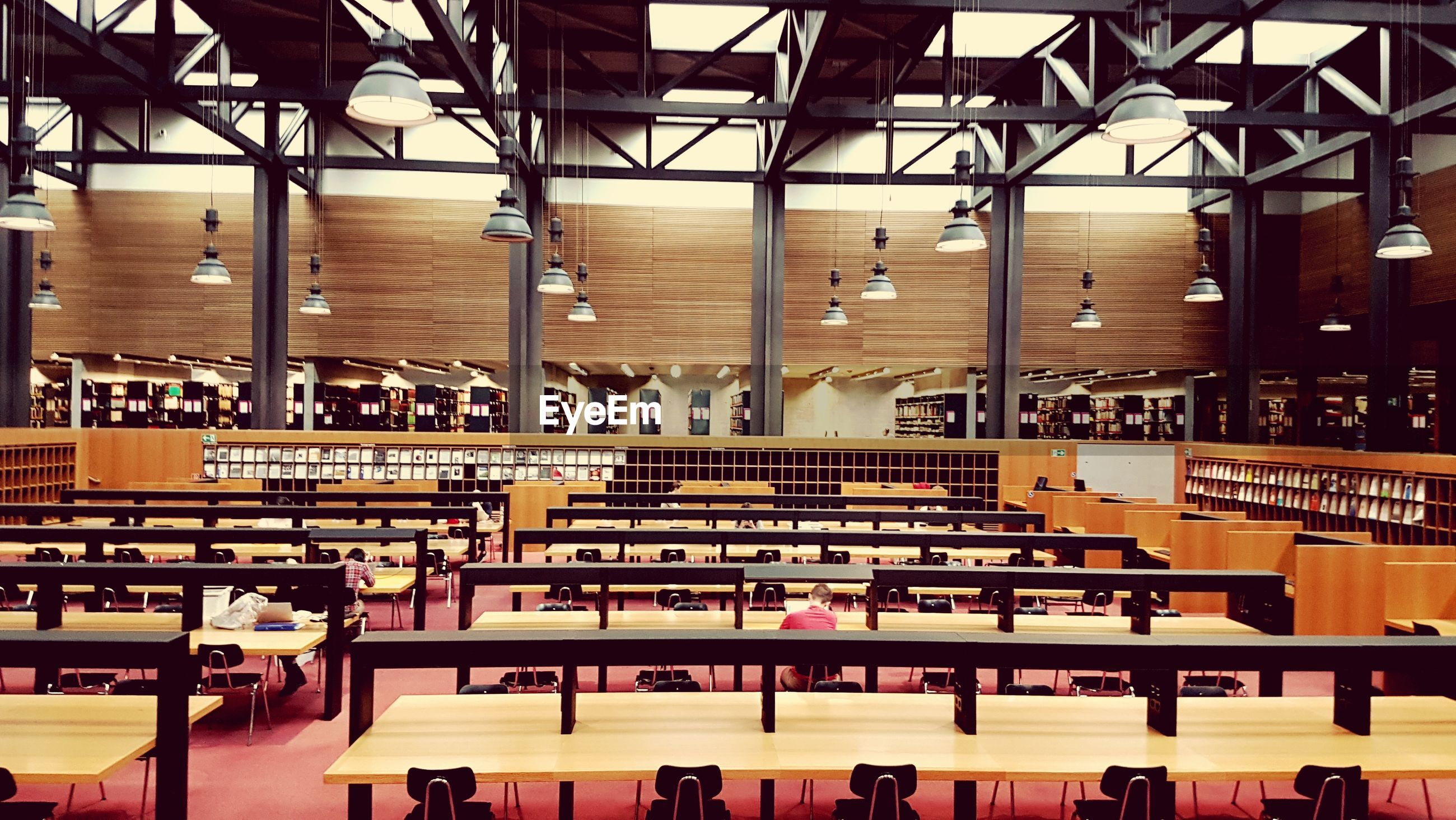 indoors, education, in a row, university, chair, real people, technology, seminar, architecture, seat, student, day