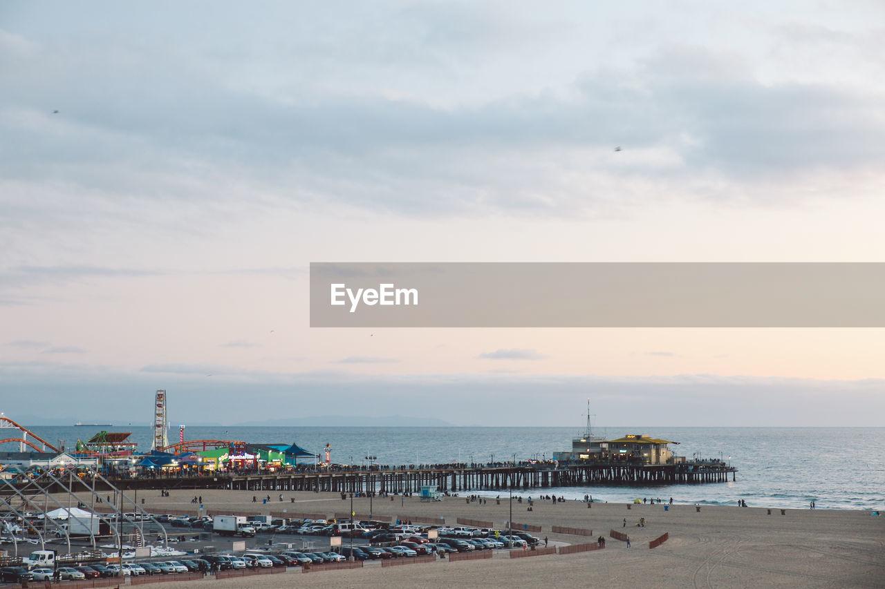 Santa Monica Pier By Sea Against Sky