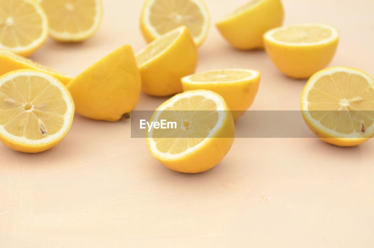 citrus fruit, food and drink, fruit, food, healthy eating, slice, wellbeing, freshness, lemon, indoors, still life, cross section, table, yellow, halved, no people, orange color, close-up, orange - fruit, orange, vitamin c