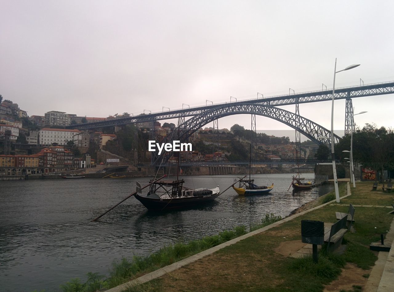 architecture, water, transportation, built structure, bridge - man made structure, river, connection, nautical vessel, outdoors, city, sky, nature, no people, day