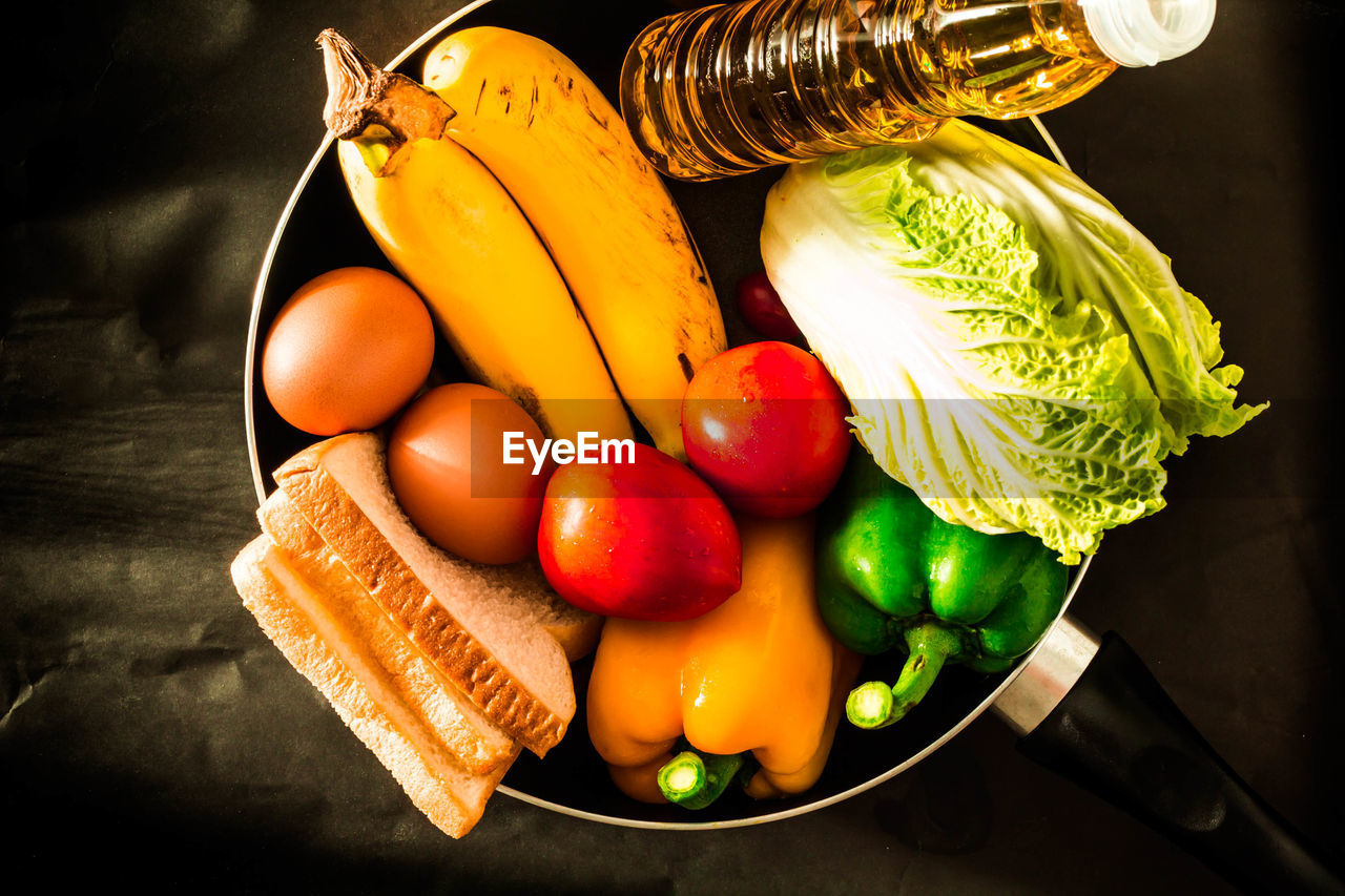 food, food and drink, healthy eating, still life, vegetable, freshness, fruit, wellbeing, indoors, high angle view, table, no people, banana, choice, variation, carrot, close-up, root vegetable, bell pepper, tomato, orange, tray