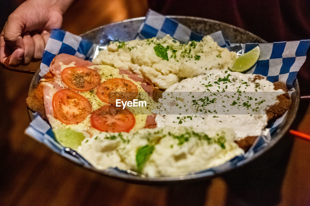 food, food and drink, ready-to-eat, freshness, indoors, healthy eating, close-up, table, egg, serving size, human hand, one person, wellbeing, kitchen utensil, hand, holding, eating utensil, meal, human body part, fried egg, breakfast, temptation, crockery, finger