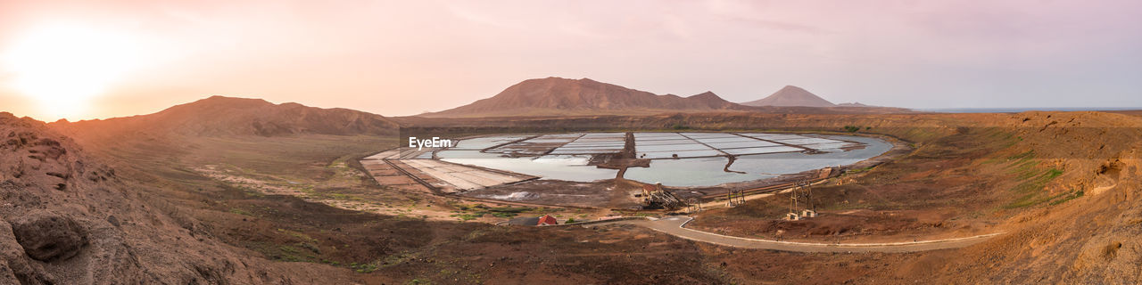 Panoramic view of salt farm against landscape