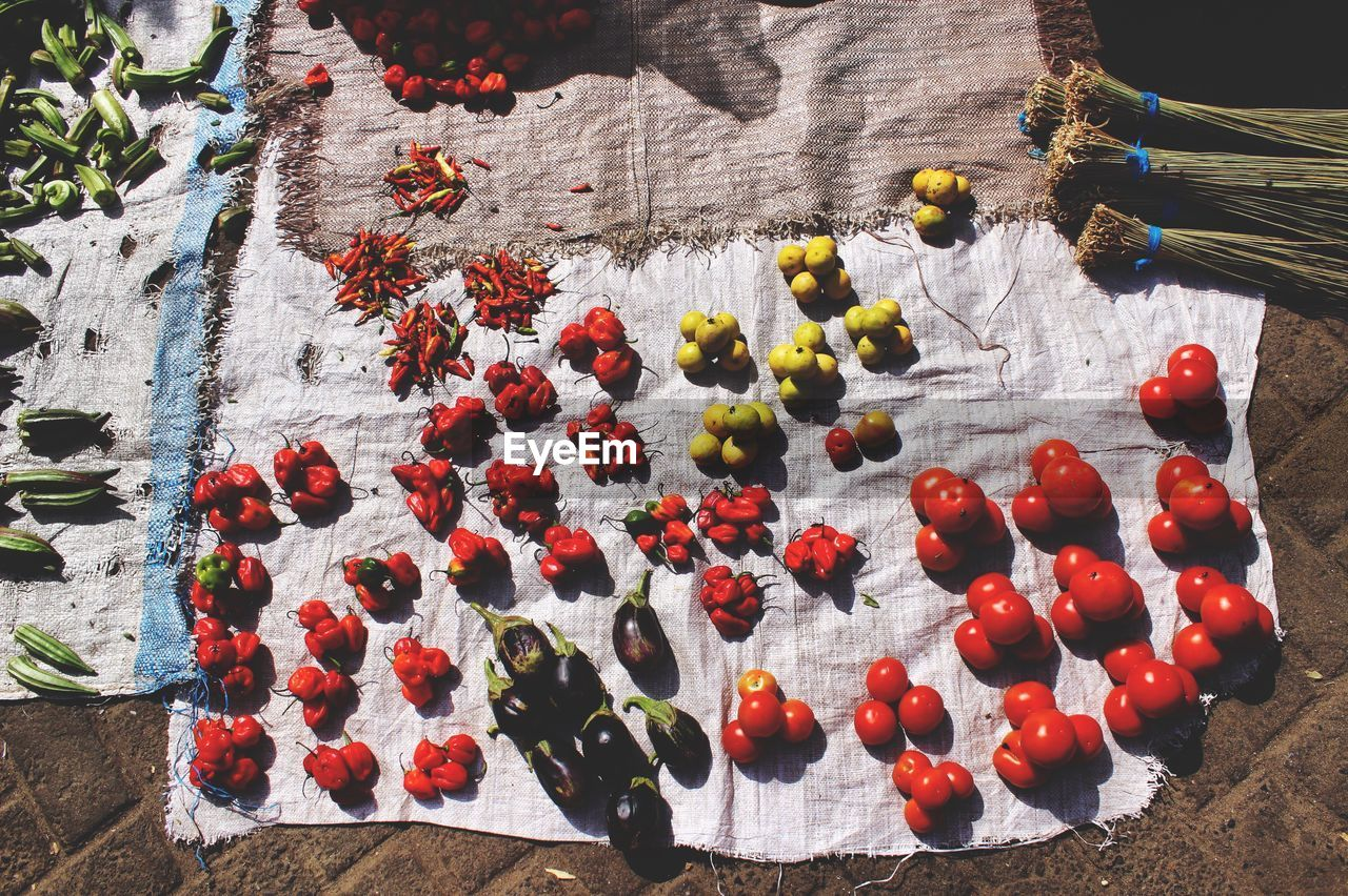 fruit, no people, food, healthy eating, food and drink, high angle view, freshness, wellbeing, day, red, nature, vegetable, wood - material, plant, tomato, outdoors, close-up, sunlight, flower, table, ripe
