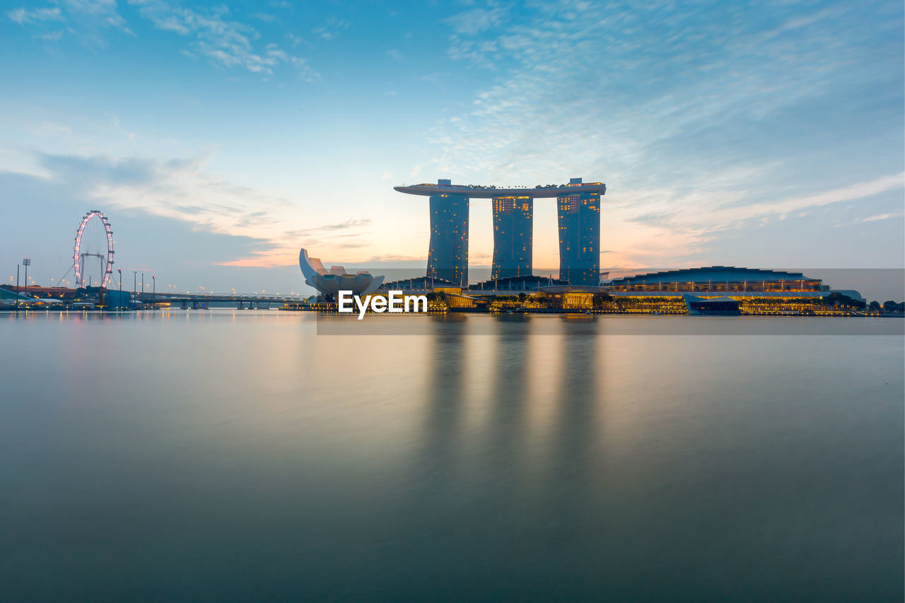 Marina Bay Sands In Front Of River Against Sky During Sunset