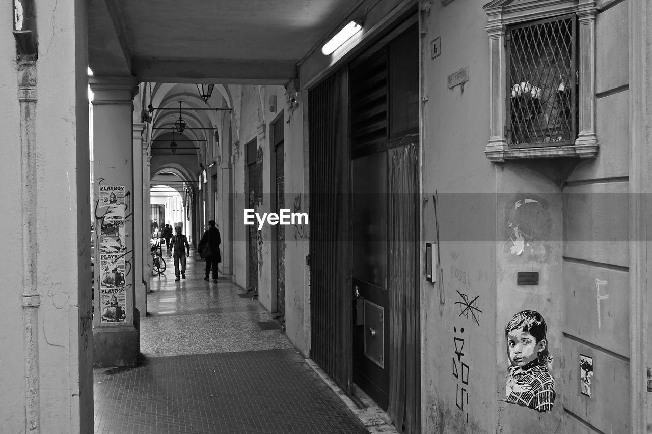 People walking on corridor in building