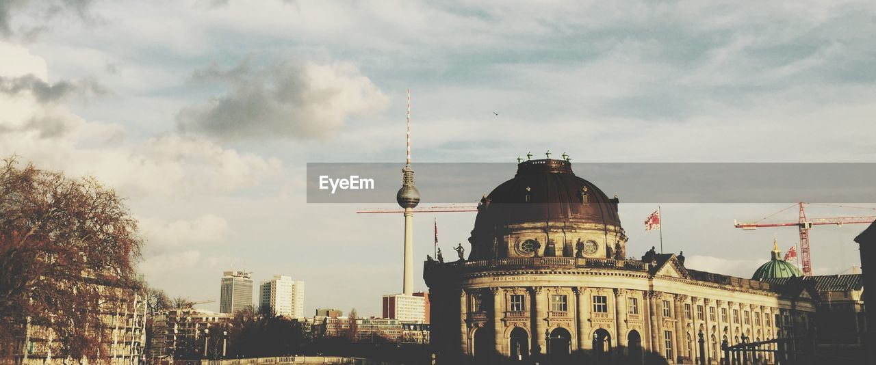 Bode-Museum And Fernsehturm Against Cloudy Sky
