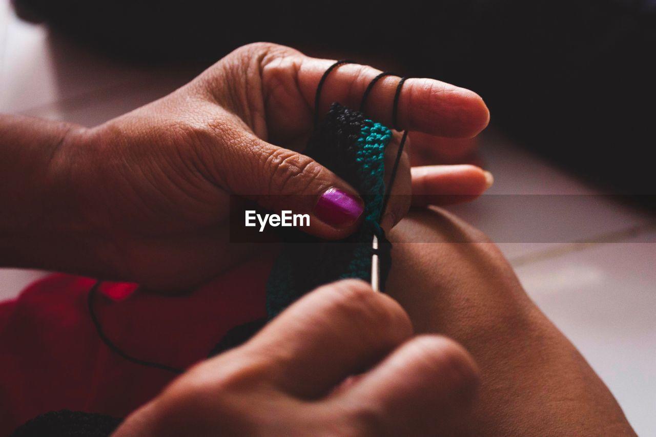 Close-Up Of Human Hand Crocheting