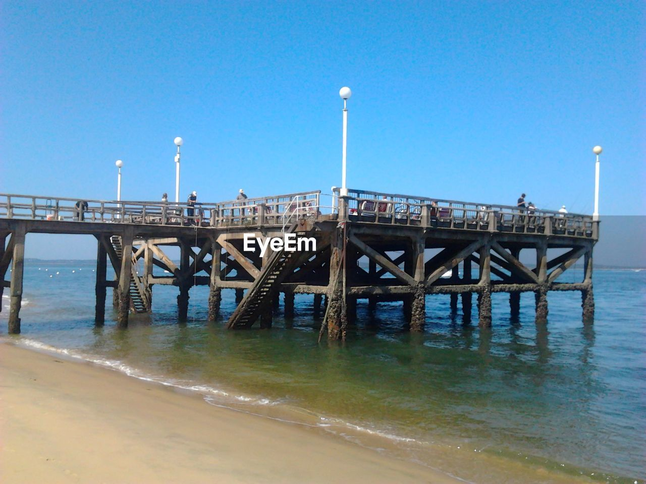 blue, water, connection, clear sky, built structure, architecture, bridge - man made structure, day, sea, no people, outdoors, beach, nature, horizon over water, sky