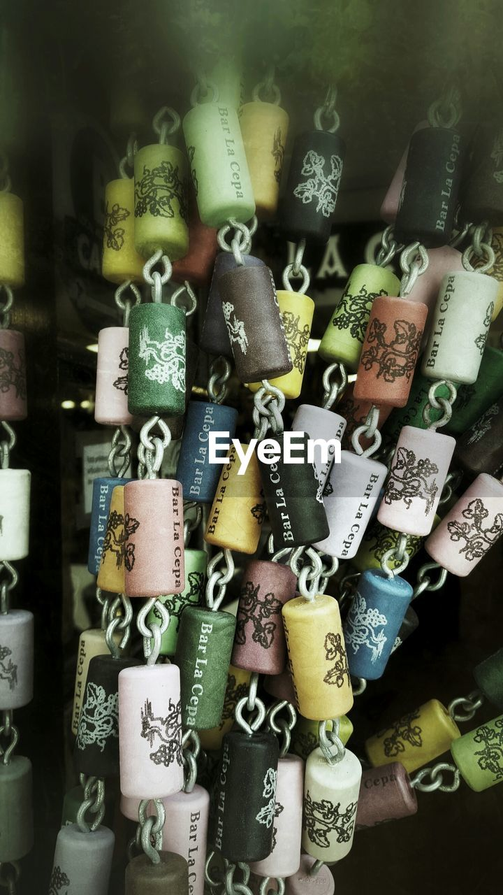 text, large group of objects, abundance, hope, love, variation, padlock, no people, close-up, full frame, communication, luck, hanging, collection, choice, lock, love lock, backgrounds, day, indoors