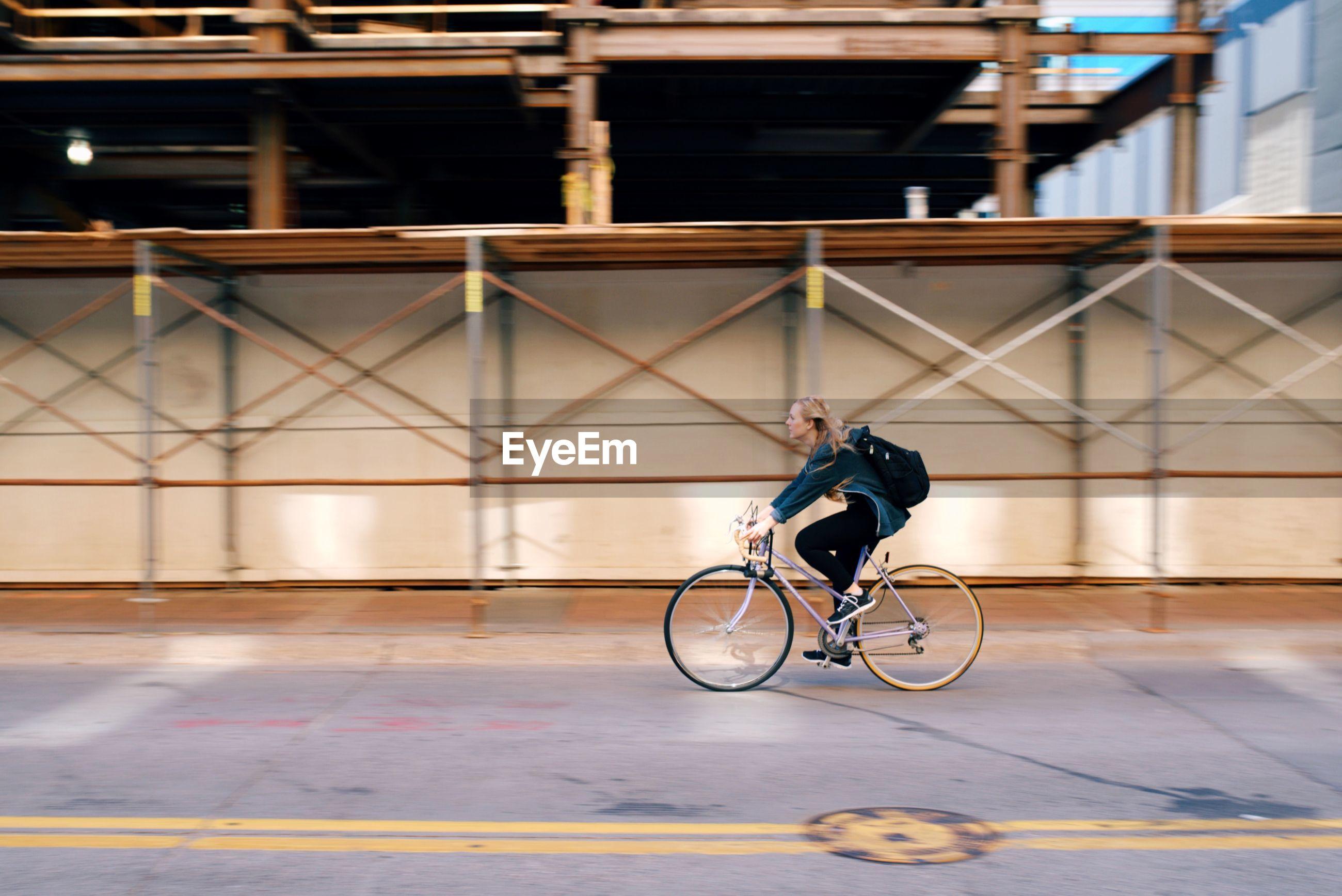 MAN RIDING BICYCLE ON BICYCLE