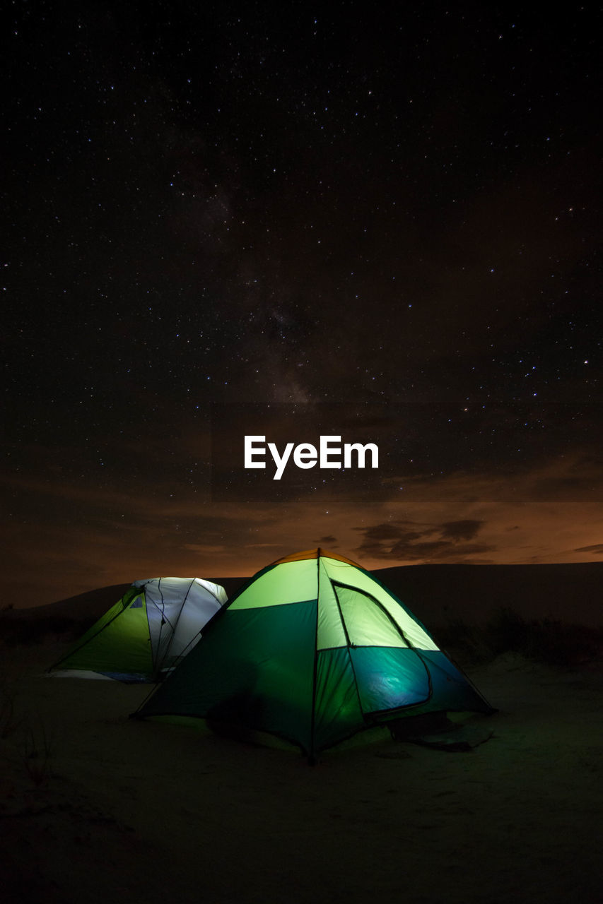 Tents Against Sky At Night