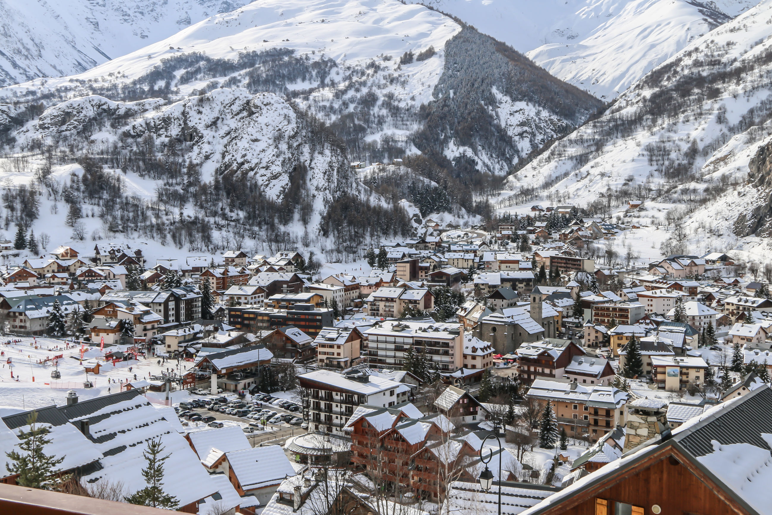 Aerial view of townscape and snowcapped mountains