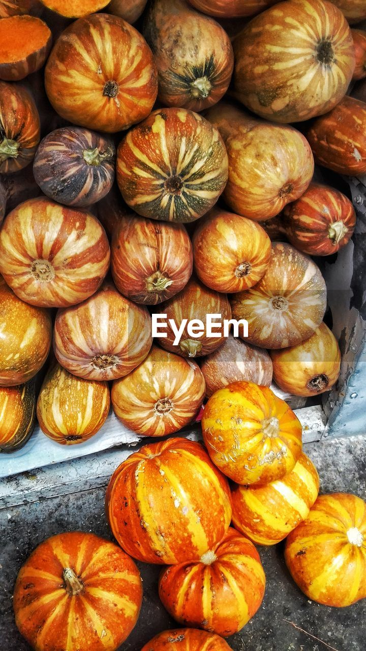 food and drink, pumpkin, food, orange color, healthy eating, freshness, vegetable, no people, abundance, retail, squash - vegetable, full frame, day, close-up, indoors, halloween