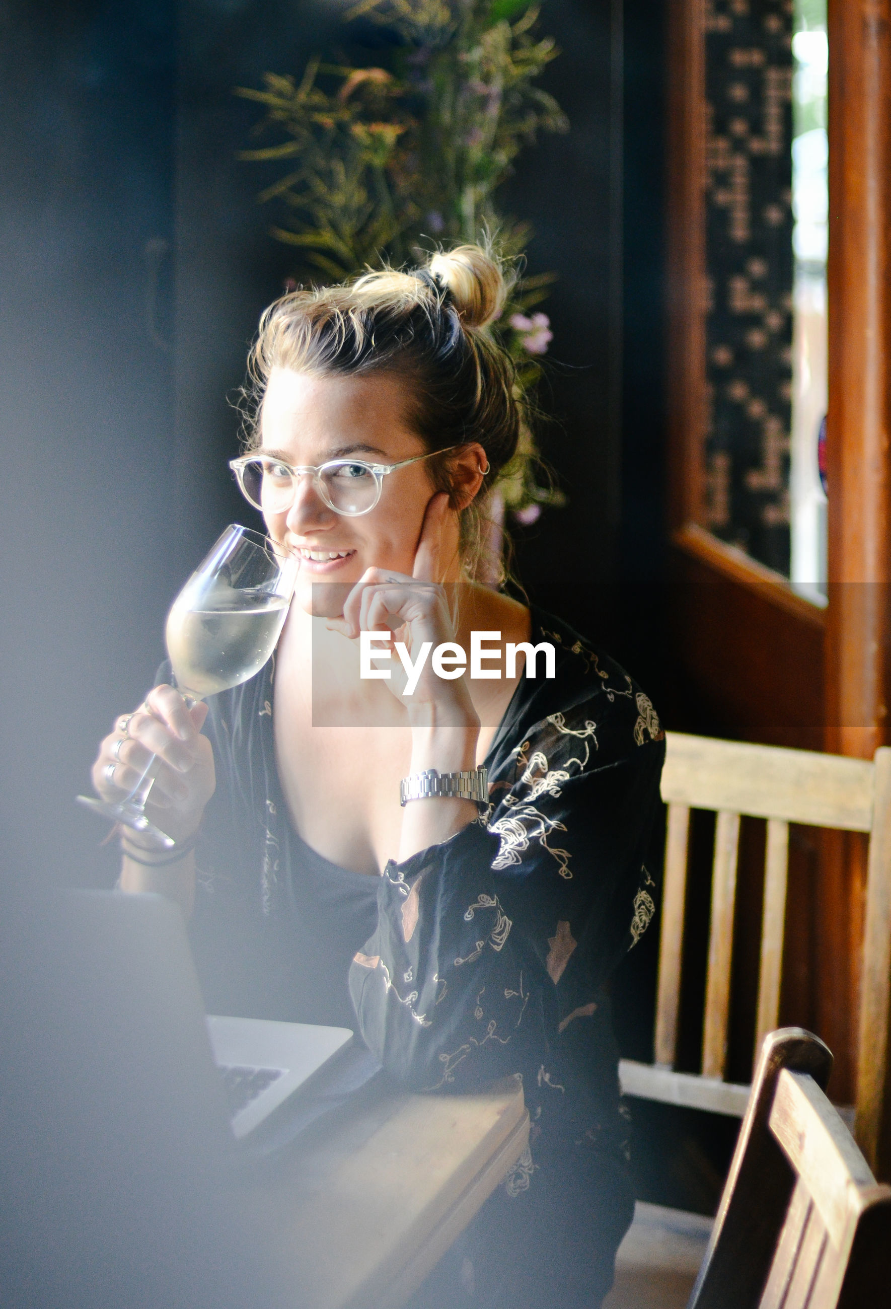 Portrait of woman drinking white wine after work