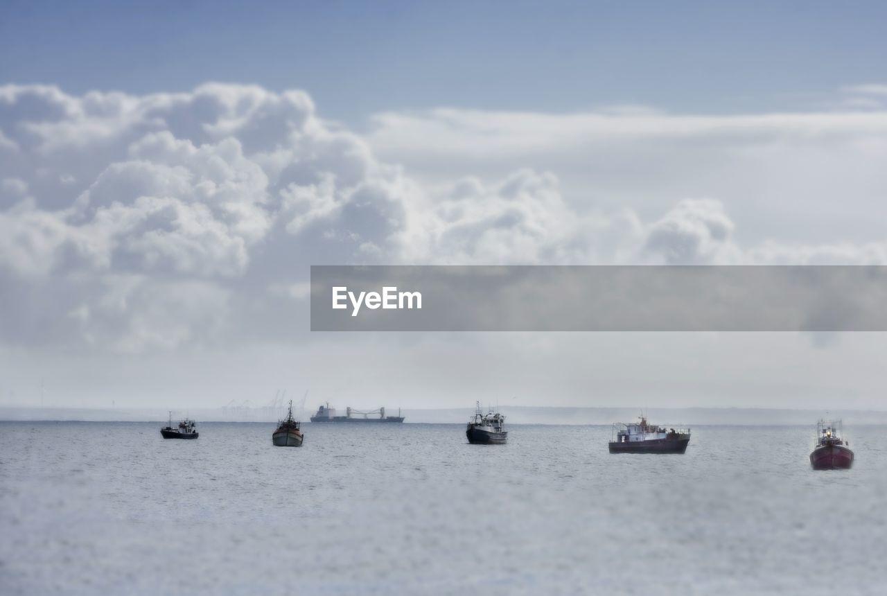 Fishing Trawlers In Sea