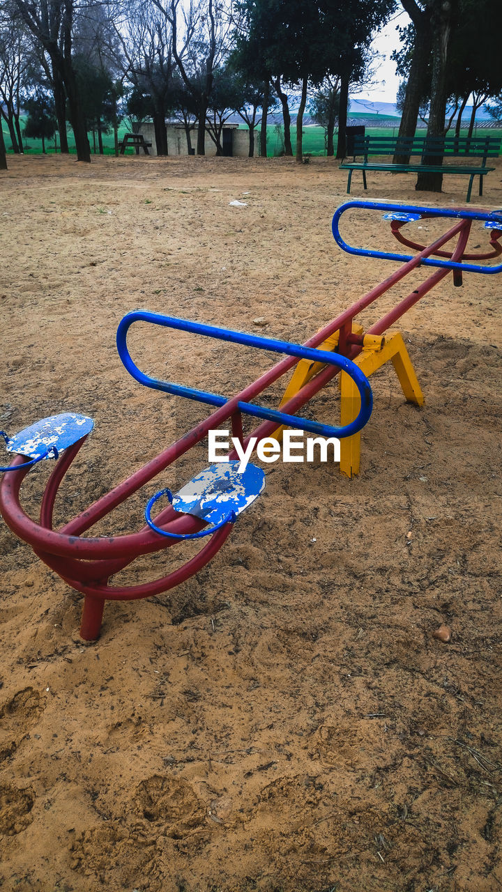 playground, childhood, outdoor play equipment, seesaw, park - man made space, tree, sand, outdoors, nature, no people, grass, day