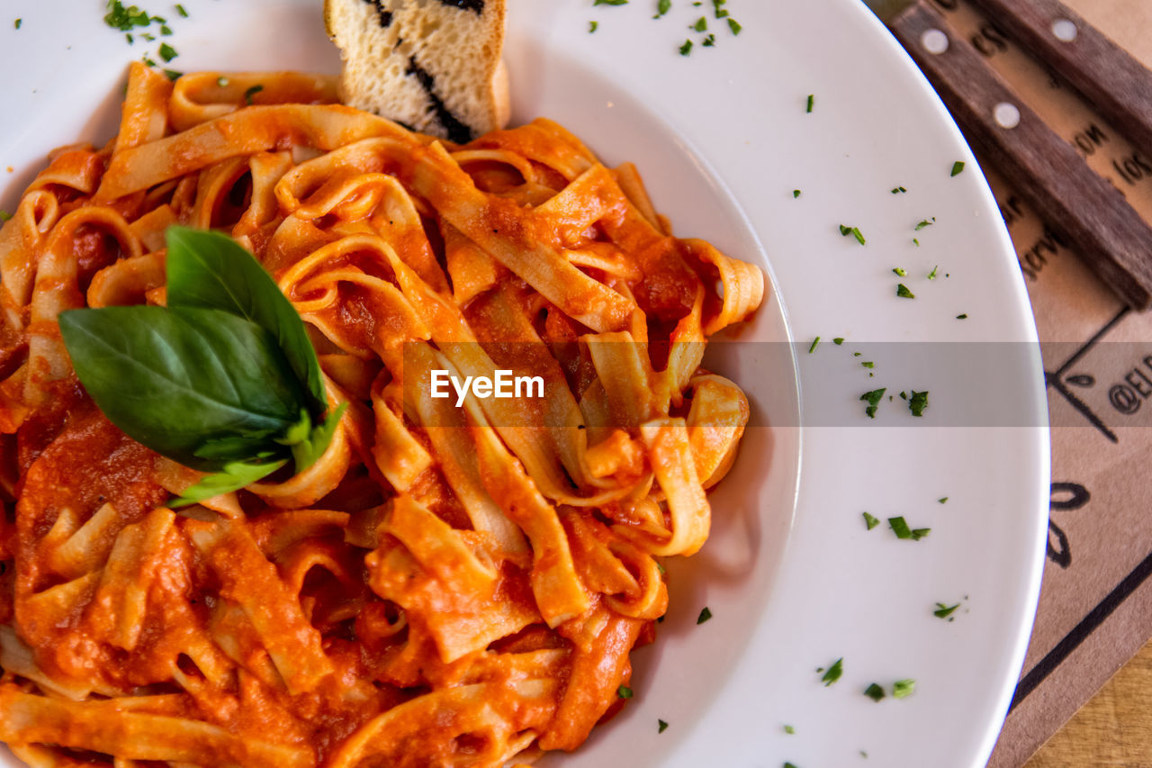 food, food and drink, ready-to-eat, plate, freshness, pasta, serving size, italian food, indoors, close-up, still life, table, spaghetti, no people, high angle view, meal, indulgence, kitchen utensil, healthy eating, herb, garnish, temptation, crockery, tomato sauce