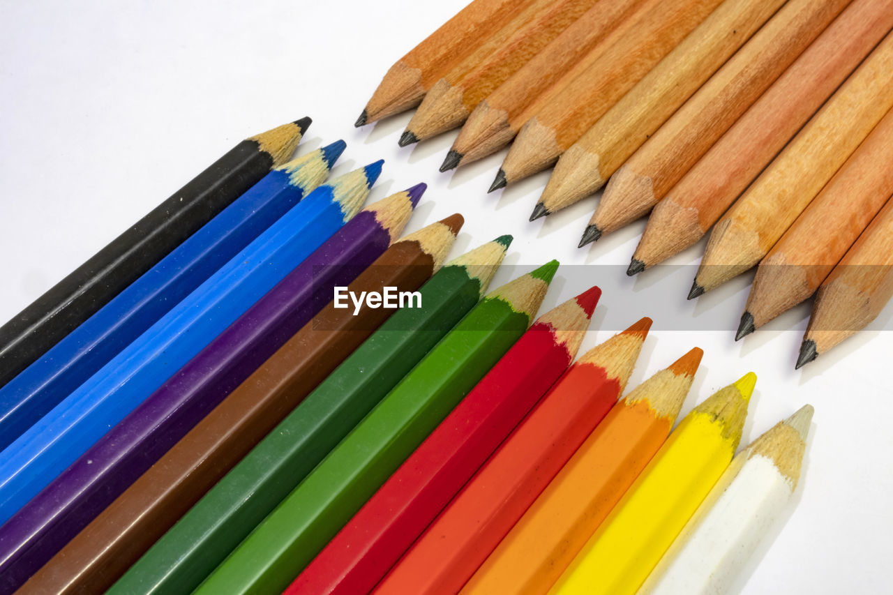 pencil, multi colored, still life, art and craft, choice, variation, studio shot, indoors, close-up, colored pencil, no people, writing instrument, white background, high angle view, sharp, craft, large group of objects, creativity, arrangement, in a row, order, art and craft equipment, variety