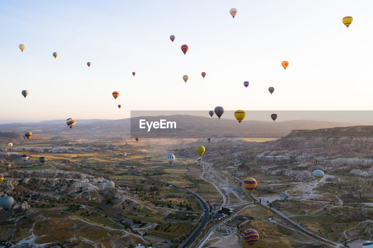 balloon, air vehicle, hot air balloon, sky, mid-air, flying, landscape, transportation, nature, environment, beauty in nature, ballooning festival, no people, mode of transportation, scenics - nature, mountain, travel, architecture, adventure, travel destinations, outdoors