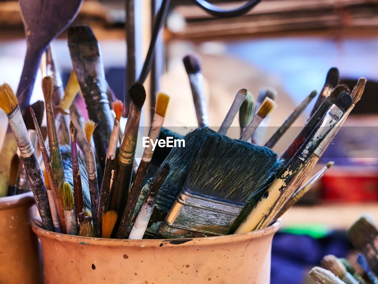 Close-up of paintbrushes in container