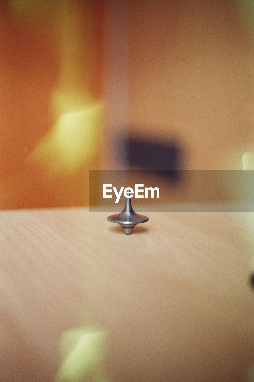 Close-up of spinning top on table
