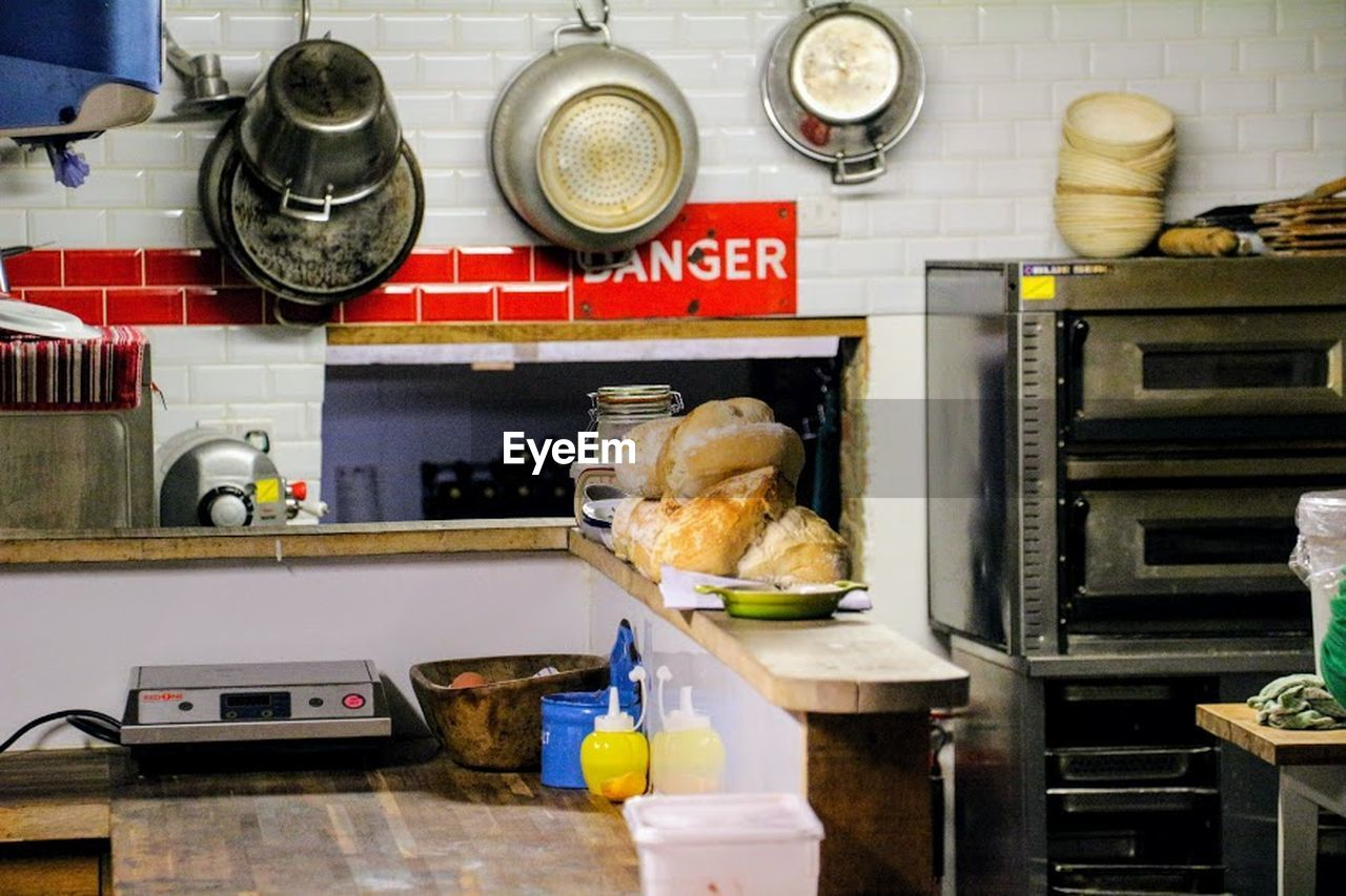 domestic kitchen, kitchen, food, commercial kitchen, indoors, kitchen counter, food and drink, stove, domestic room, food and drink establishment, no people, day, freshness
