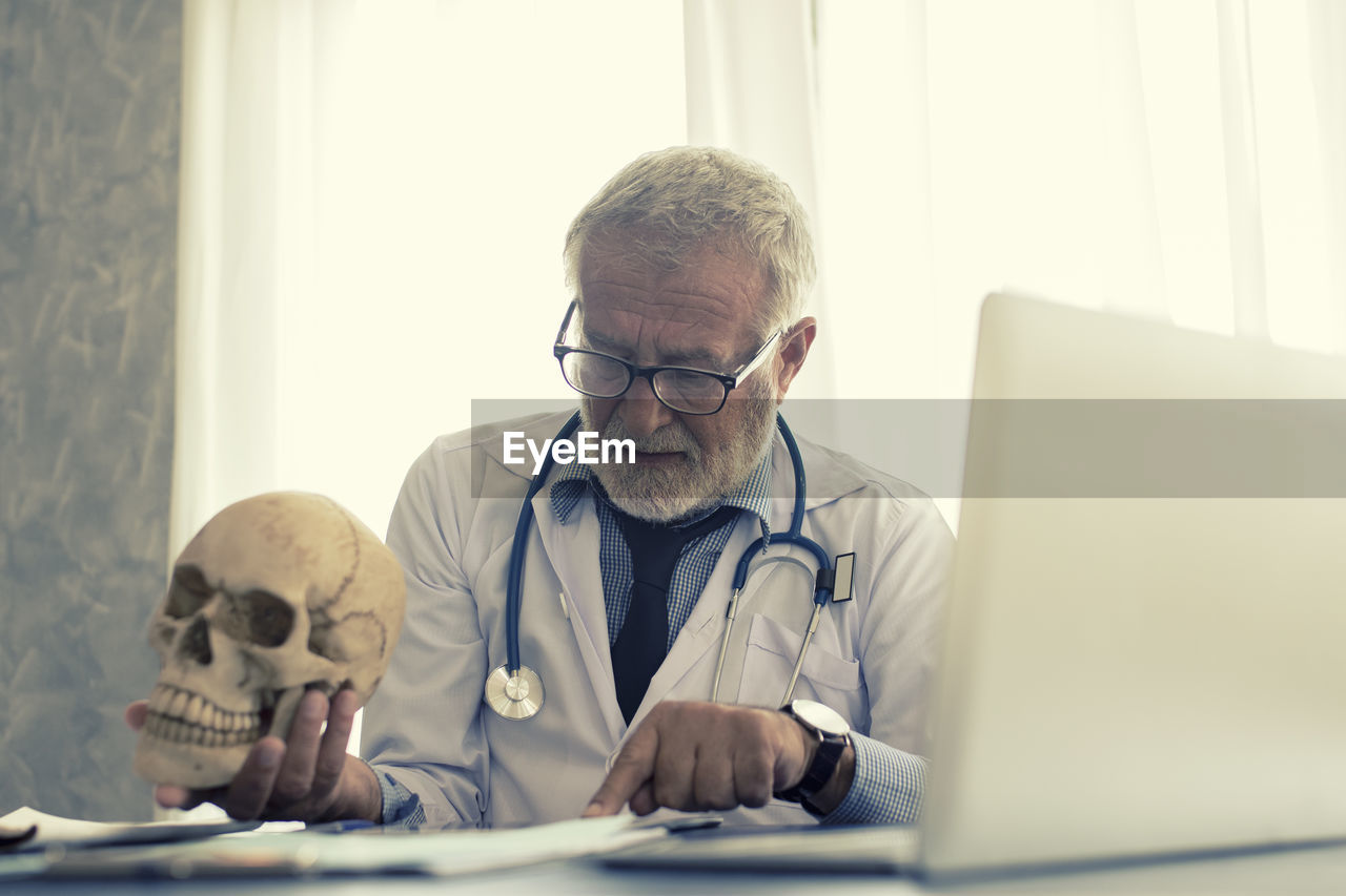 Doctor With Skull Reading Document