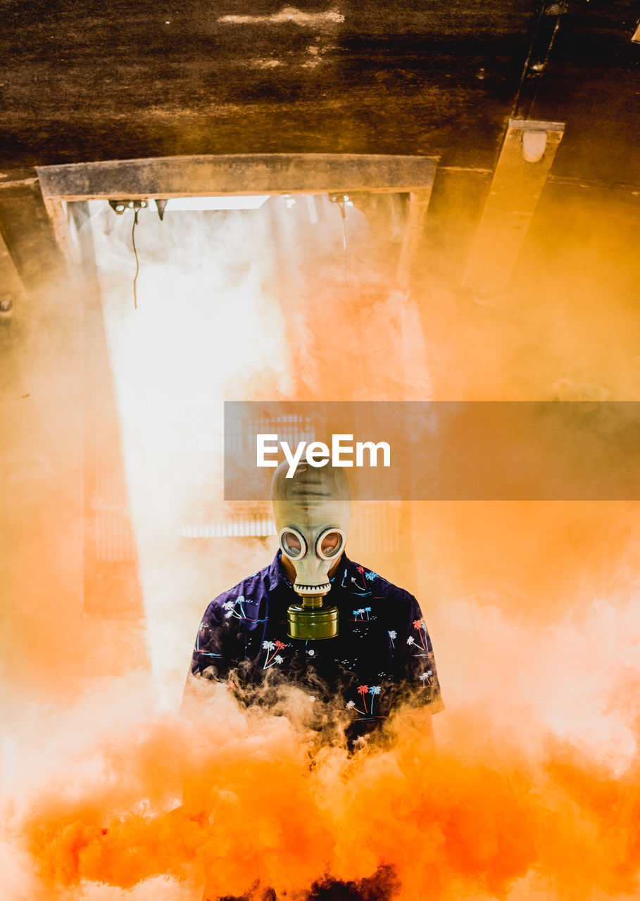occupation, fire, smoke - physical structure, protective workwear, men, firefighter, communication, safety, burning, fire - natural phenomenon, adult, protection, warning sign, security, sign, accidents and disasters, headwear, rescue, people, front view, uniform, heroes, mature men, rescue worker, responsibility, outdoors, fire hose