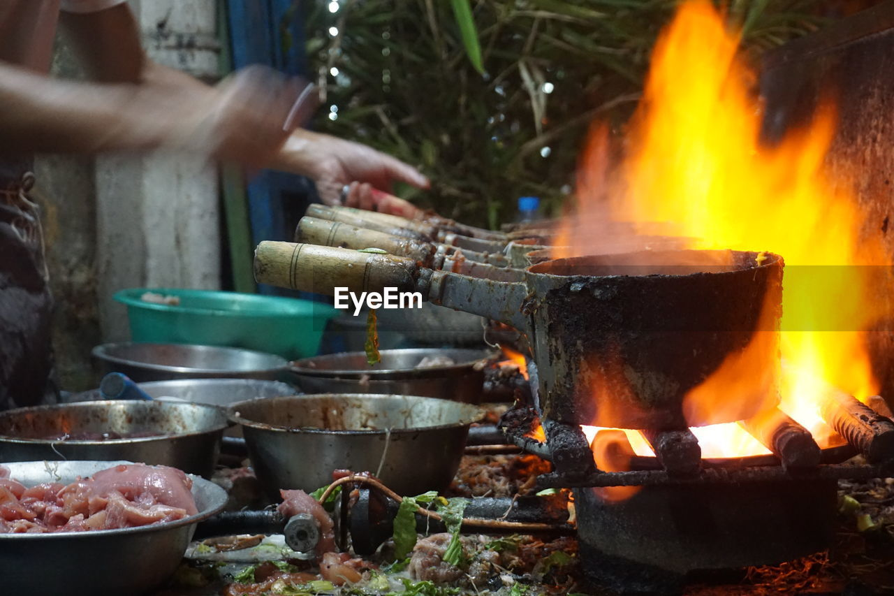View Of Person Cooking On Fire Outdoors