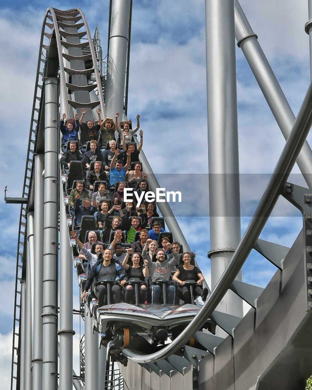 Low Angle View Of Roller Coaster Ride Against The Sky
