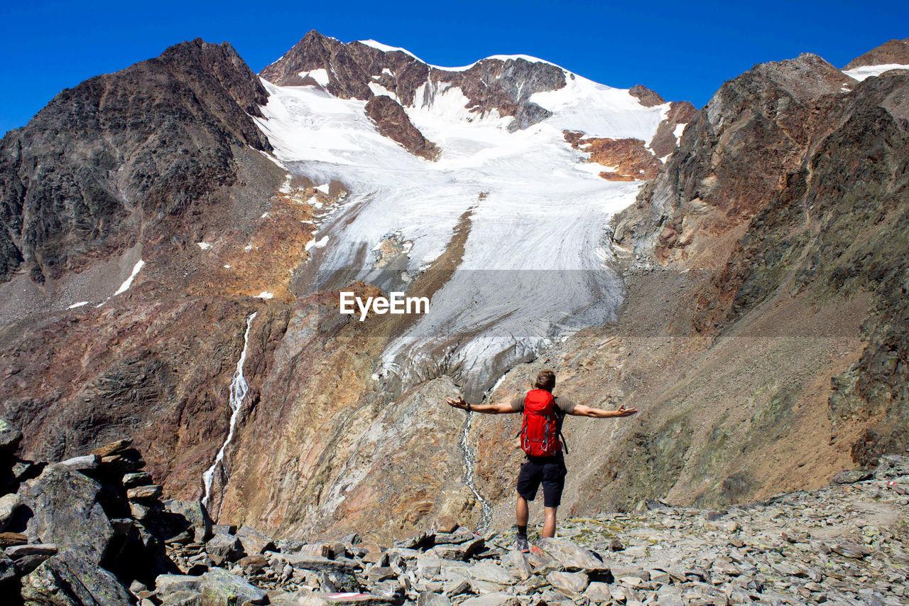 Man Standing Against Grossglockner Mountain Against Sky