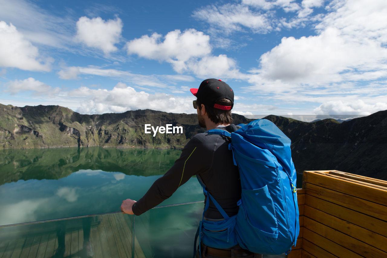 Man Looking At Lake By Mountains